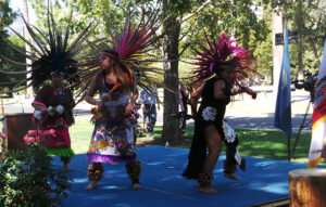The Maquilli Tonatiuh, an Aztec dance group, perform the Blessings of the Four Corners at the Chavez Peace Bench Dedication / International Day of Peace celebration at State Capitol World Peace Rose Garden.