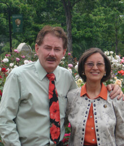 "ose Man"" and Sylvia Villalobos smiling in the rose garden"