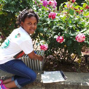 Girl revealing a plaque