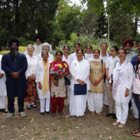 Sikh & Brahma Kumaris poeple in festive clothes gathered for a picture