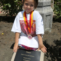 a girl next to a plaque