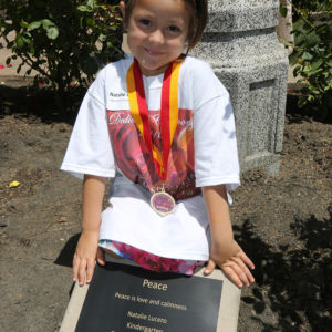 a girl next to a plaque