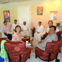 People of different nationalities gathered around a coffee table