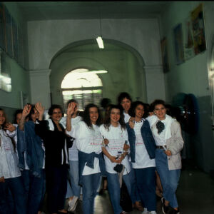 Students wearing withe and blue clothes gathered for a picture