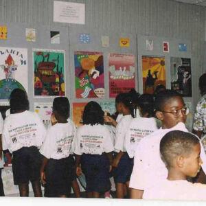African-American children looking at art dispay