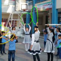 Children dancing with hula hoops