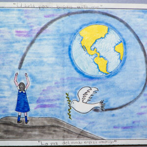 A girl is sanding a white dove to fly around the Earth