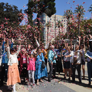 People tossing rose petals in the air