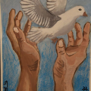 Two strong hands releasing a white dove into the blue